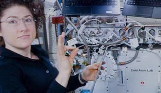 Christina Koch assists with a hardware upgrade for NASA's Cold Atom Lab