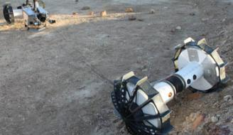 DuAxel rover separates into two single-axled robots